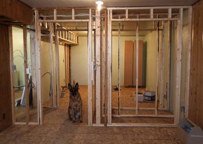 Tessa inspecting some bedroom framing.