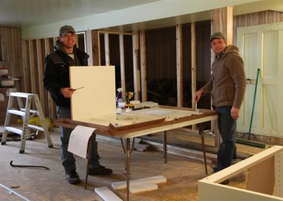 George and Corny planning out the new cabinets.