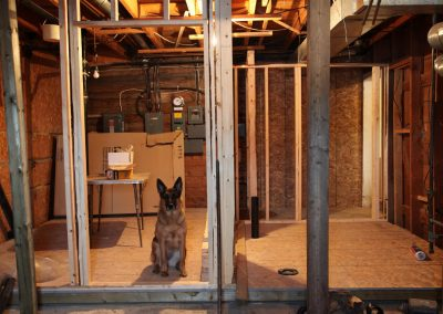 Tessa inspecting the washroom framing.