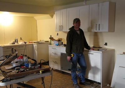 George nearly completing the first kitchen.