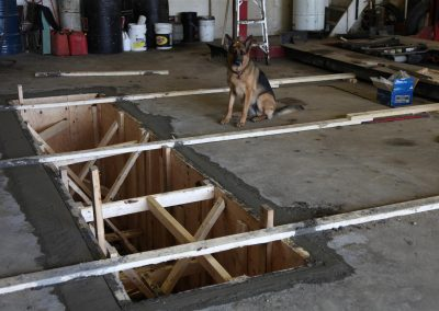 Tessa inspects the forms for the new pit.