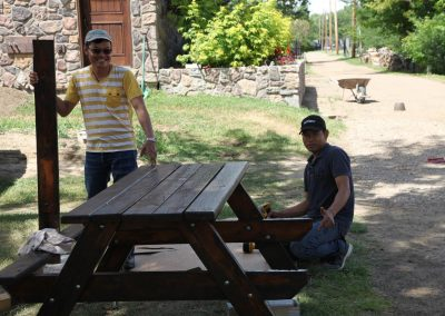 Bop and Chai refinishing the picnic table