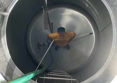 Reece cleaning one of our homogenizing tanks.  Absolutely spotless!