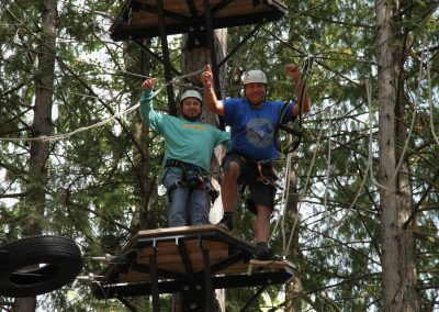 Guicho and Javier 50 feet up in the trees.